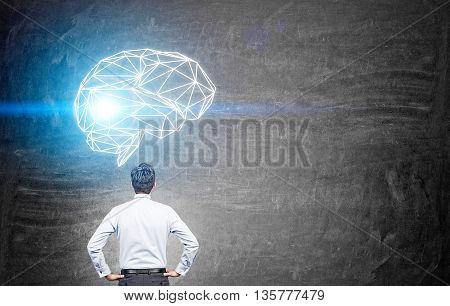 Man Looking At Brain Sketch