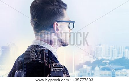 Stylish thoughtful businessman in glasses on city background. Closeup Double exposure