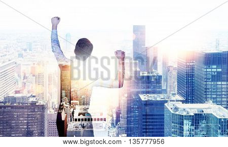 Back view of businessman celebrating his success on New York city background with sunlight. Double exposure