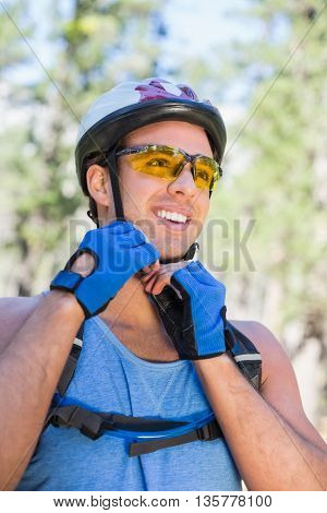Low angle view of man wearin helmet at forest