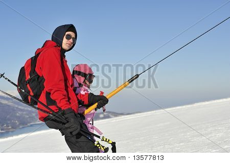 Boy and girl on the skilift