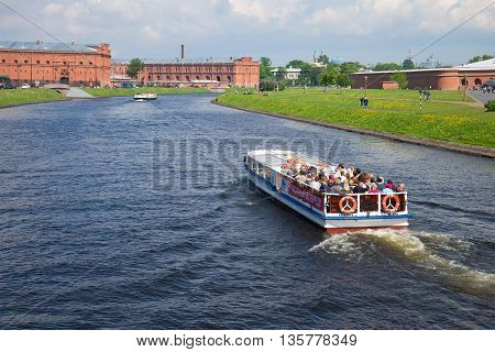 SAINT PETERSBURG, RUSSIA - MAY 22, 2016: The ship is sailing in the strait Kronverksky with tour group, sunny day in may. Tourist landmark of the city St. Petersburg