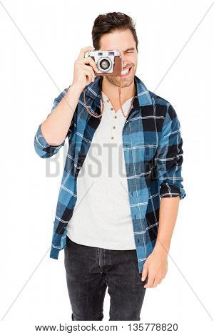 Man photographing with camera on white background