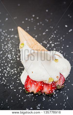 Vanilla ice cream cone fell on the black background