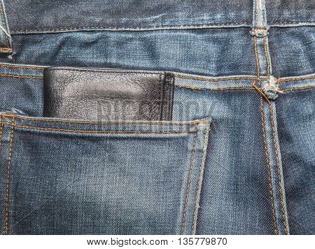 Jeans texture Blue denim jeans with black lether wallet (focus on wallet)