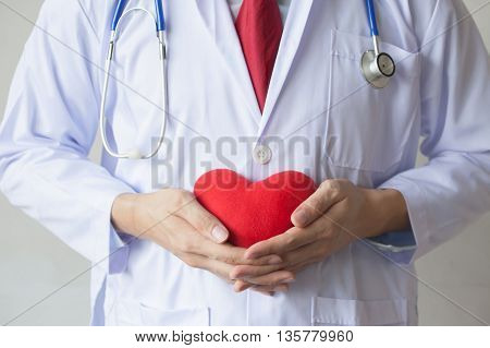 Doctor Showing Support Holding Red Heart