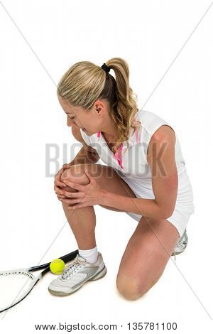 Injured athlete with tennis racket and tennis ball on white background