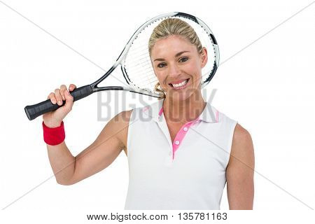 Portrait of happy athlete holding racquet on white background
