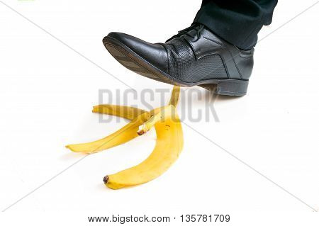 Walking Businessman Is Going To Slip On Banana Peel.