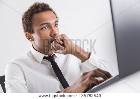 Handsome Black Guy Using Laptop
