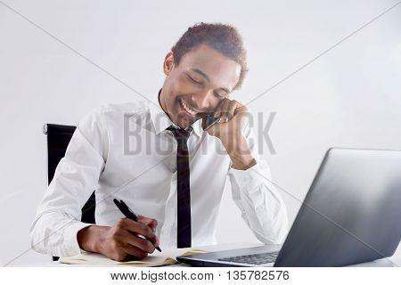 Friendly Black Businessman On Phone