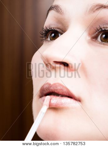 Beautiful young woman eyelash extension. Woman eye with long eyelashes. Beauty salon concept, lipstick lip gloss.