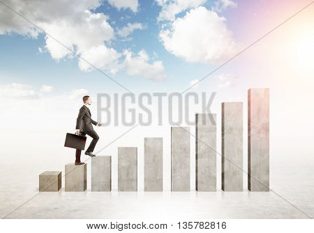 Financial growth concept with businessman climbing abstract upward business chart bars on sky background