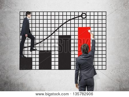 Success concept with businessmen drawing and walking on grid with business chart on concrete background