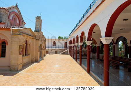 HERAKLION CRETE-JULY 25: Monastery of Panagia Kalyviani arched courtyard on July 25 2014 on the Crete island Greece. The Monastery of Panagia Kalyviani is located 60km south of Heraklion.
