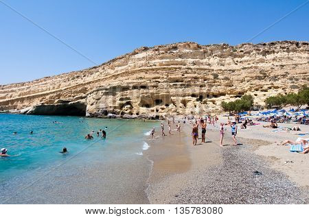 CRETE GREECE-JULY 22: Matala beach with the caves on Libyan sea on July 222014 Crete Greece.