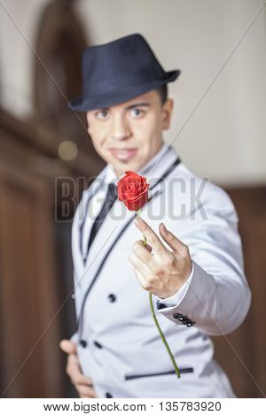 Tango Dancer Holding Fresh Rose While Performing In Restaurant