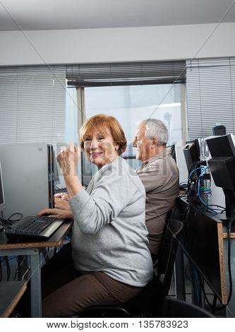 Senior Woman Cheering In Computer Class