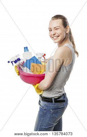 attractive beautiful young woman in yellow rubber gloves holding pink basin with detergents over white