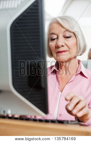 Senior Student Using Computer In Classroom