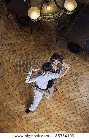 Confident Tango Dancers Performing On Hardwood Floor