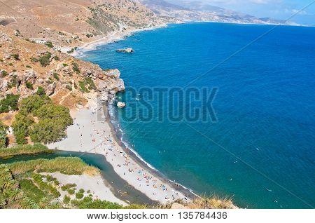 Preveli beach and lagoon seen from the mouth of the Kourtaliotiko gorge on the Crete island Greece.