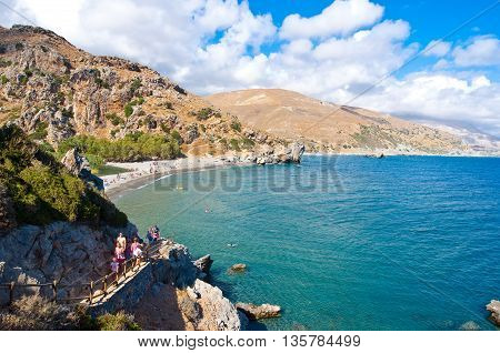 CRETEGREECE-JULY 23:People go down to the Preveli Beach on July 232014 on Crete Greece. The beach of Preveli is situated 40 km south of the main town and is the most idyllic beach in Crete.