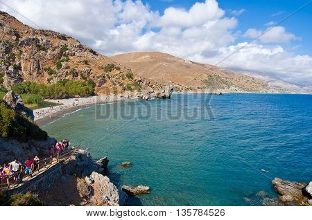 CRETEGREECE-JULY 23:Tourists go downstairs to the Preveli Beach on July 232014 on CreteGreece. The beach of Preveli is situated 40 km south of the main town and is the most idyllic beach in Crete.