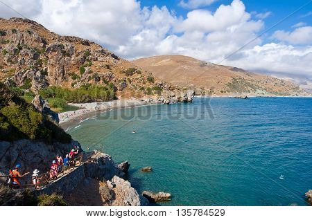 CRETEGREECE-JULY 23:Tourists go down the steps to the Preveli Beach on July 232014 on Crete Greece. Preveli Beach is situated 40 km south of the main town and is the most idyllic beach in Crete.