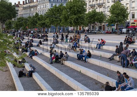 LYON, FRANCE - MAY 16, 2015: On the embankment of the Rhone in the evening is a favorite place of meetings of youth.