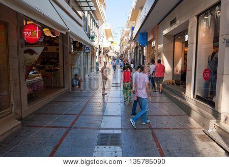 CRETE HERAKLION-JULY 25: Shopping street Dedalou on July 25 2014 in Heraklion on the island of Crete Greece. Daidalou Street is a pedestrian area lined with tourist shops.