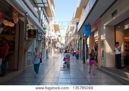CRETE HERAKLION-JULY 25: Shopping street Dedalou on July 25 2014 in Heraklion on the island of Crete Greece. Daidalou Street is a paved pedestrian street lined with tourist shops.