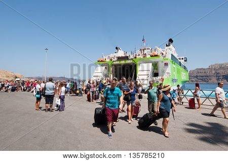 SANTORINI-JULY 28: Tourists arrive in the port of Thira or Santorini on July 28 2014 in Greece.