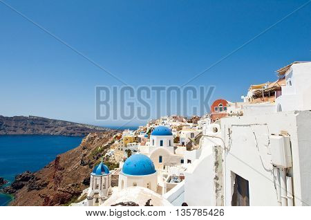The edge of the caldera with white houses on the island of Santorini Greece.