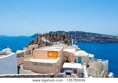 SANTORINIOIA-JULY 28: Group of tourists on the top of Oia castle on July 282014 in Oia town on the Santorini island Greece.