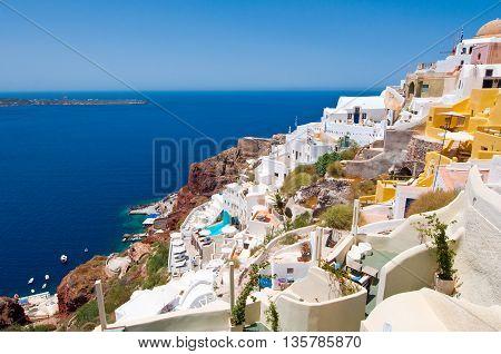 Colorful Oia town on the edge of the Santorini Caldera cliffs on the island of Thira (Santorini) Greece.