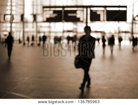 blur silhouette people in train station sepia tone