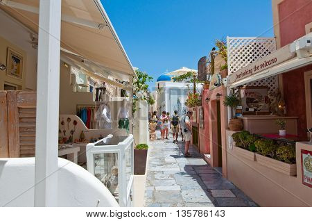 SANTORINIOIA-JULY 28: Shopping street on July 28 2014 in Oia village on the Santorini island Greece. Oia is a small town on the islands of Thira (Santorini) and Therasia Greece.