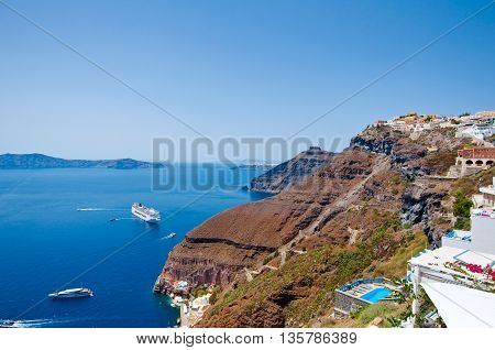 Fira landscape and skyline on the edge of caldera. Thira (Santorini) Greece.