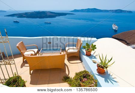 Patio with flowers in Fira on the island of Thira (Santorini) Greece.