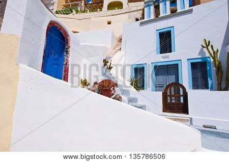 Fira whitewashed buildings carved into the rock on the edge of the caldera cliff on the island of Thira (Santorini) Greece.