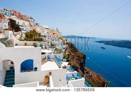Panorama of Fira town on the edge of the caldera cliff on the island of Thira (Santorini) Greece.