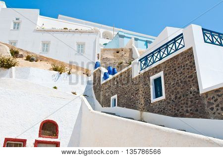 Fira cosy street on the island of Thira (Santorini) Greece.