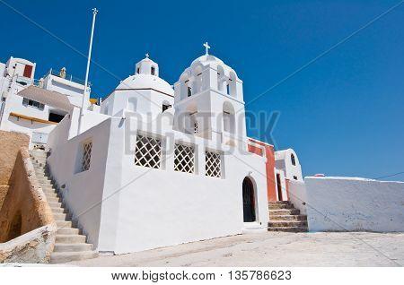Orthodox church on the edge of caldera. Fira the island of Santorini Greece.