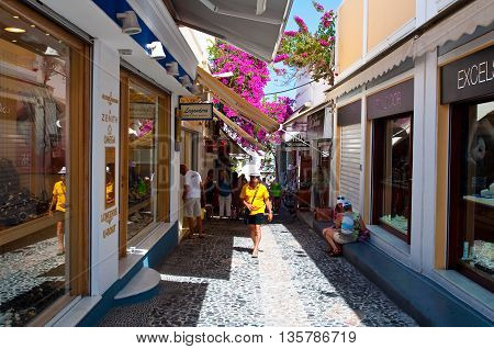 SANTORINI FIRA-JULY 28: Narrow shopping street on July 28 2014 in Fira town on the Santorini island in Greece. Firá is the modern capital of the Greek Aegean island Santorini.
