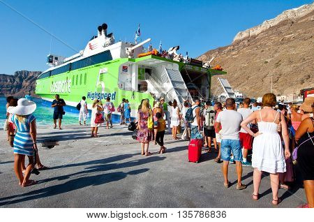 SANTORINI-JULY 28: Group of tourists leave the Santorini on July 28 2014 from the port of Thira. Santorini Greece.