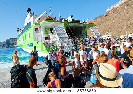 SANTORINI-JULY 28: Tourists leave the Santorini on July 28 2014 from the port of Thira. Santorini Greece.