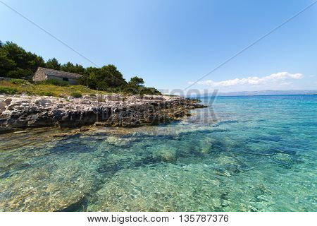 Panorama of an old house on the beach. Stone house on the beach in dalmatian Island of Korcula,Croatia.Beautiful peaceful island with crystal clear sea full of wildlife.Active summer, diving location