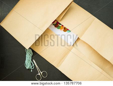 gift packing in kraft paper and green thread