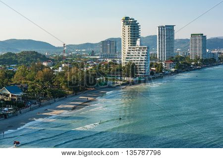 Aerial view of sea shore beaches with skyline of modern city on the background. Hua Hin Thailand